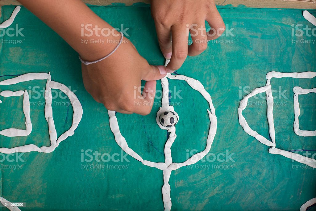 Soccer toys made of clay. stock photo
