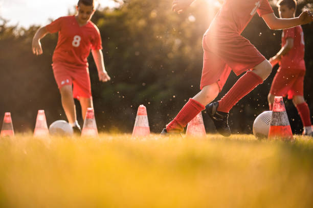 soccer training at sunny day - soccer league stock pictures, royalty-free photos & images