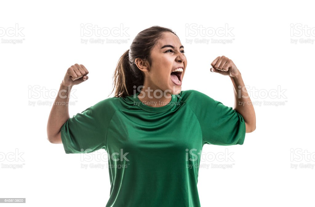 Soccer woman celebrating on green uniform isolated on white background stock photo