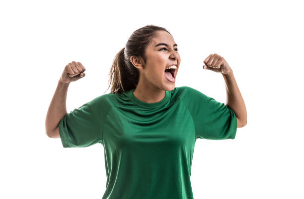 soccer woman celebrating on green uniform isolated on white background - fan enthusiast stock photos and pictures