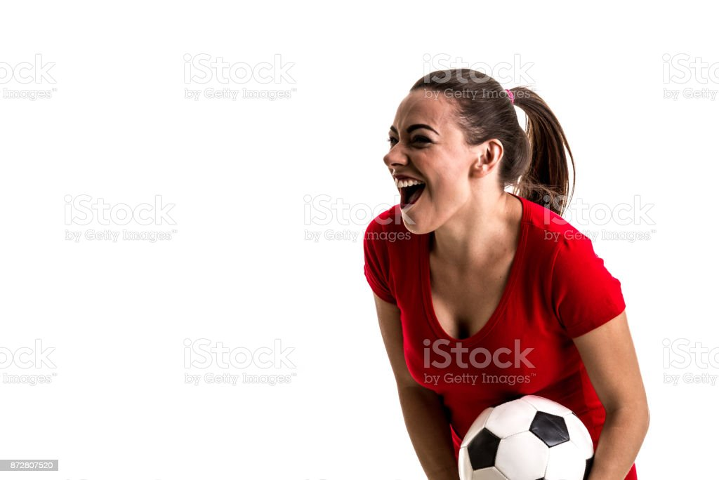 Soccer woman on red uniform isolated on white background stock photo