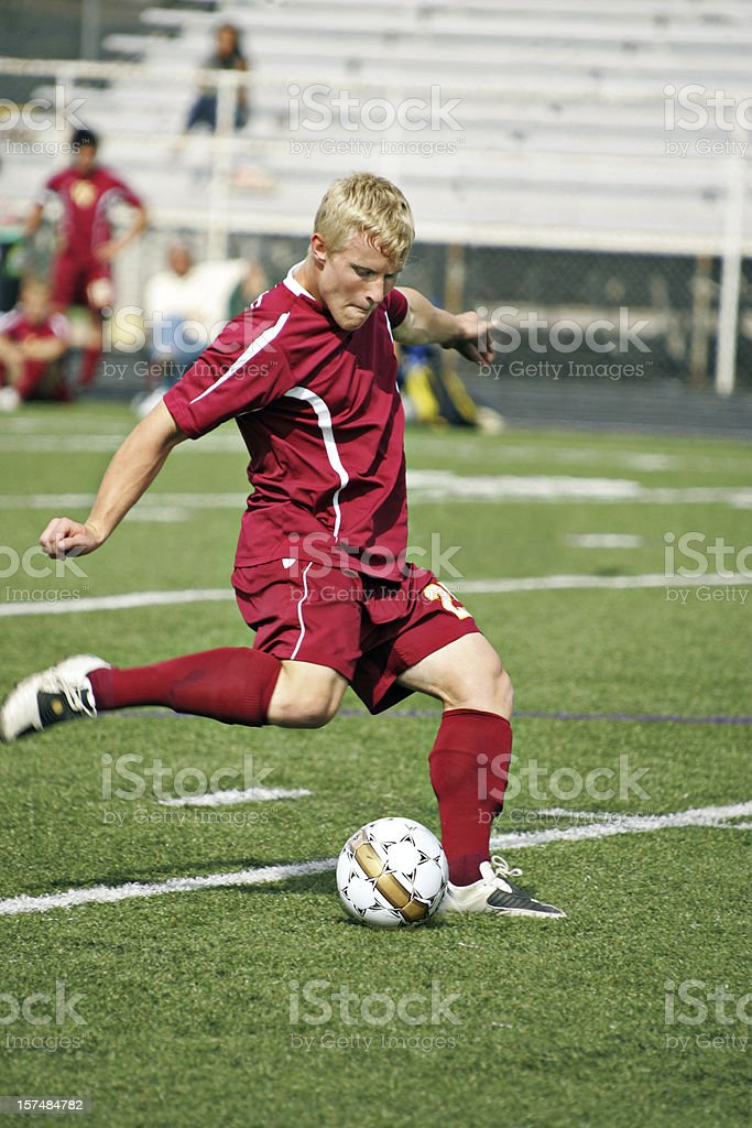 Soccer Young Man Flexs for Muscular Plant and Kick royalty-free stock photo