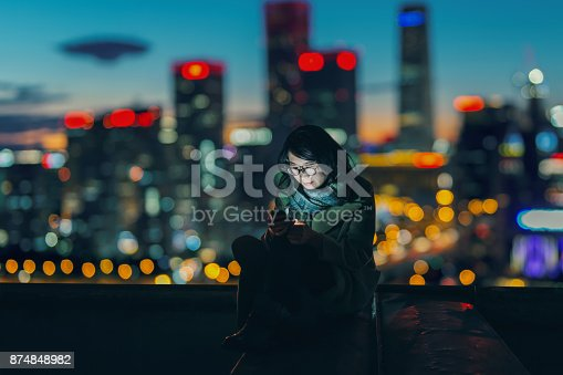 istock Social Connecting in Urban city at Night 874848982