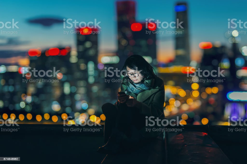 Social Connecting in Urban city at Night stock photo