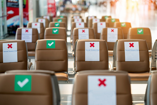 Social distance concept. keep spaced between each chairs make separate for social distancing, increasing physical space between people to avoid spreading illness during transmission of COVID-19.
