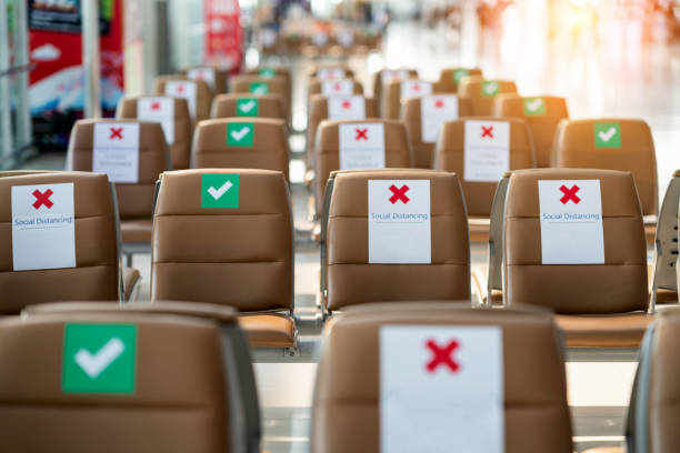 social distance concept. keep spaced between each chairs make separate for social distancing, increasing physical space between people to avoid spreading illness during transmission of covid-19. - covid flight imagens e fotografias de stock