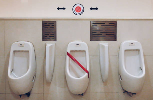 Social distance in the toilet stock photo