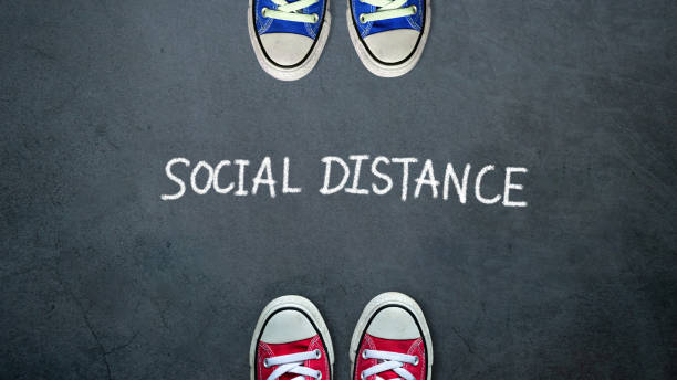 social distance. two people keep spaced between each other for social distancing, increasing the physical space between people to avoid spreading illness during transmission of covid-19 outbreak - social distancing stock pictures, royalty-free photos & images