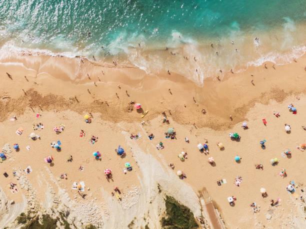 Social distancing at the beach - Summer 2020 - Coronavirus stock photo