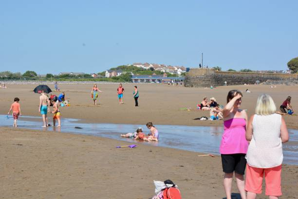 Social distancing beach days at Barry's old harbour and watchtower bay stock photo