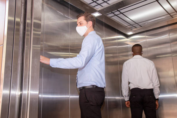 Social distancing concept on the elevator. stock photo