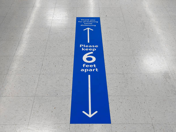 social distancing floor sign warning about safe distance between people of 6 feet. public health measure to prevent further spread of new corona virus covid-19 infections. - social distancing stock pictures, royalty-free photos & images