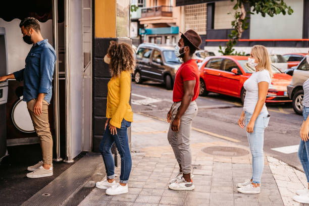 Social distancing in line at ATM stock photo