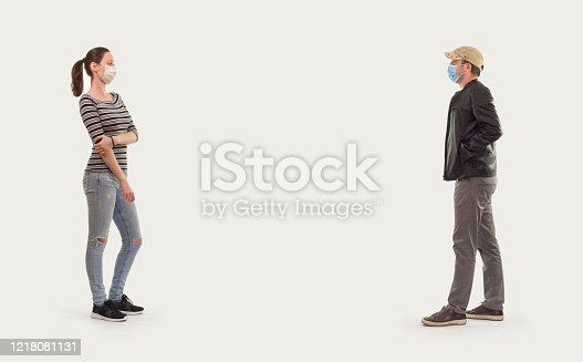 Social distancing, man and woman standing with distance for avoid virus