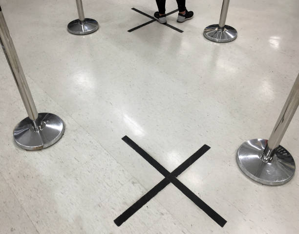 Social distancing marks on bank floor stock photo