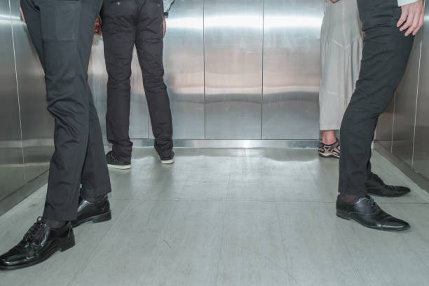Social Distancing on Elevator with passenger stand in the corner stock photo