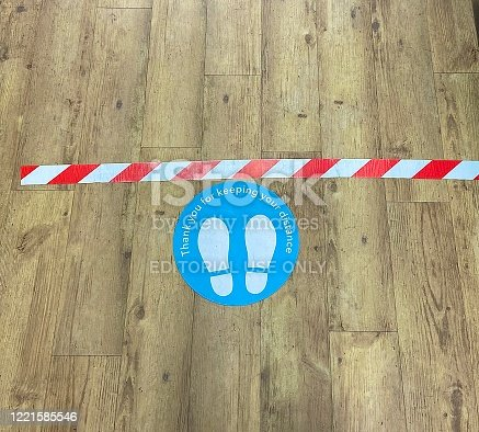 London, United Kingdom - April 21 2020: social distancing sign in shop during lockdown