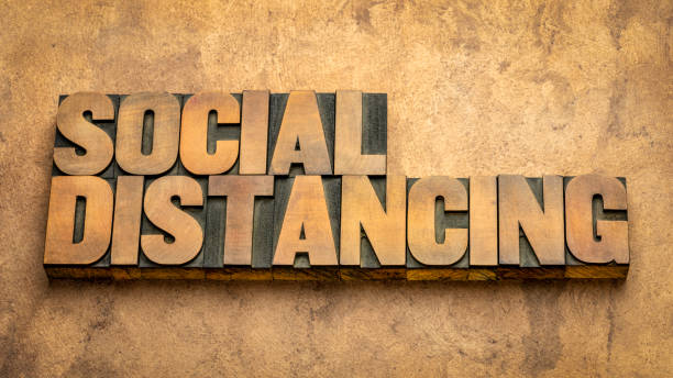 social distancing word abstract in wood type stock photo