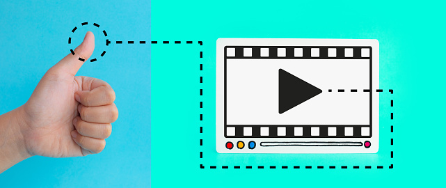 1125605742 istock photo Social entertainment and online marketing concepts with customer thumb up and fram of video movie on colorful background.digital trending 1143760889