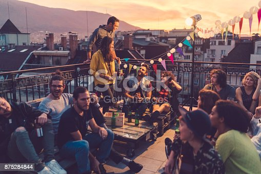 istock Social gathering on the rooftop 875284844