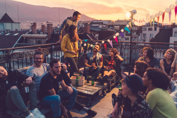 social gathering on the rooftop - party social event stock pictures, royalty-free photos & images