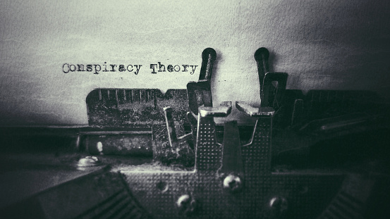 Conspiracy Theory text typed on paper with old typewriter stock photo