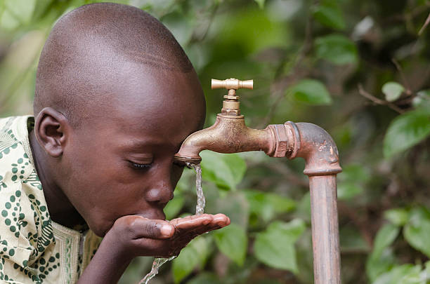 social issues: african boy in need for clean water - democratic republic of the congo stock photos and pictures