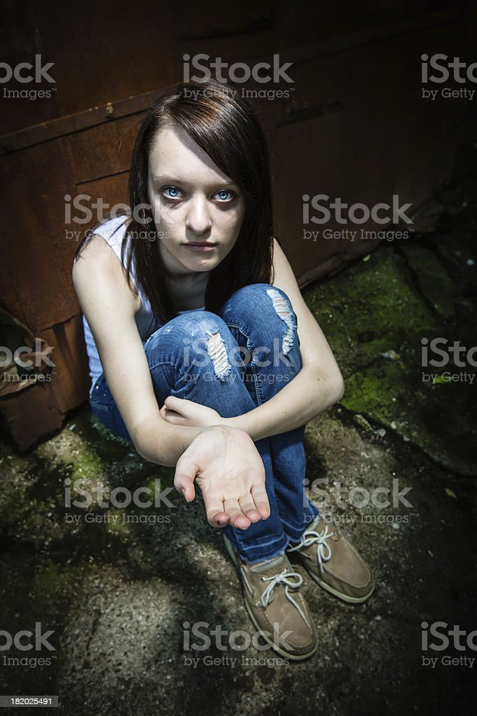 Social Issues: Scared and lonely runaway royalty-free stock photo