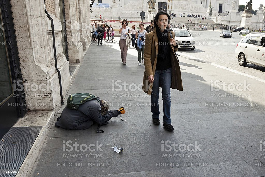 Social Issues: woman begging money in Rome Rome, Italy - October 25, 2011: Woman begging money and people walking by near the monument to Victor Emmanuel in piazza Venezia. Adult Stock Photo