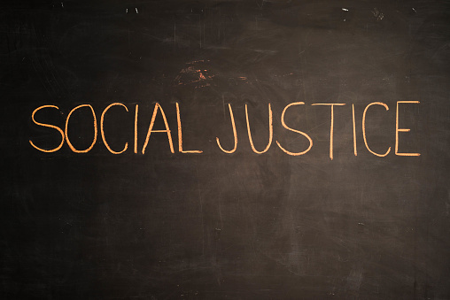 istock TEXT Social Justice against black backdrop - Illustration 646741896