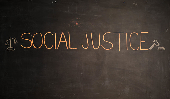 istock TEXT Social Justice against black backdrop - Illustration 966674460