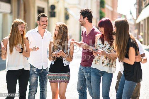 644191686 istock photo social media addiction people using the smartphone on the street 477203922