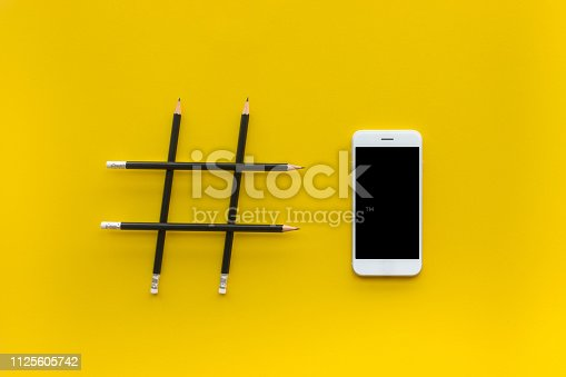 istock Social media and creativity concepts with Hashtag sign made of pencil and smartphone 1125605742