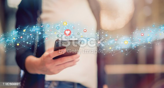 istock Social media and digital online concept, woman using smartphone and show technology icon. 1182866691