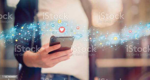 Photo of Social media and digital online concept, woman using smartphone and show technology icon.