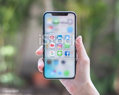istock BANGKOK, THAILAND - July 10, 2019: Social media app icons on Iphone X screen smartphone with mobile internet network technology application for people digital 4.0 business communication lifestyle. 1162047517