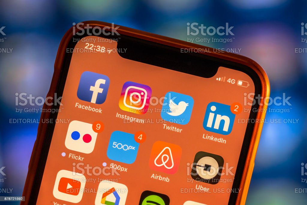 Social media app icons on modern new smartphone stock photo