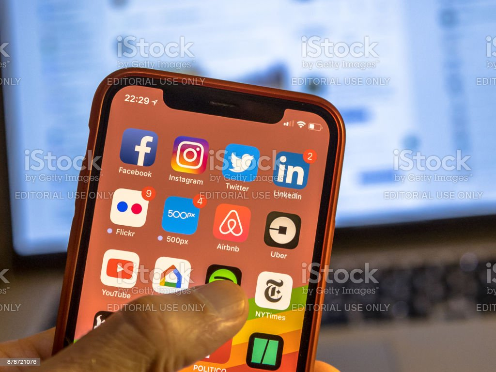 Social media app icons on new iphone stock photo
