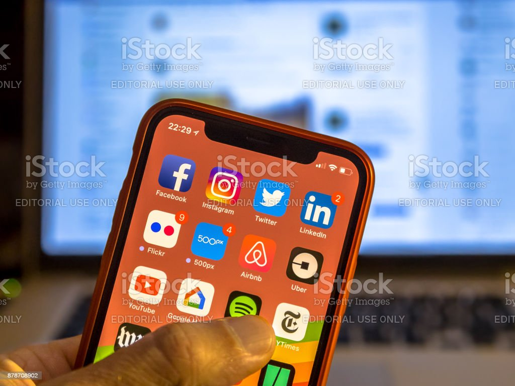 Social media app icons on new smartphone stock photo