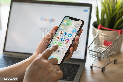 istock Social media app multi-channel icons on iphone X touchscreen mobile computer cross-channel internet application technology shopping lifestyle in digital 4.0 age 1127202755