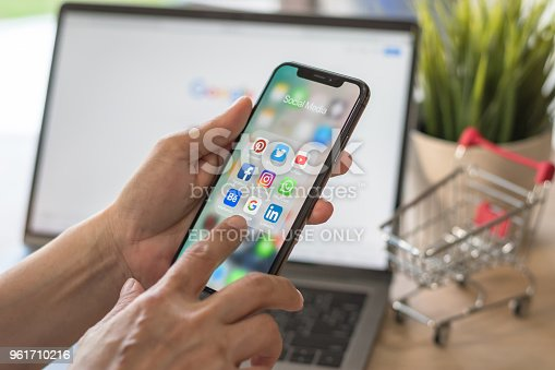 BANGKOK, THAILAND- March 17, 2017: Social media app multi-channel icons on iphone X touchscreen mobile computer cross-channel internet application technology for shopping lifestyle in digital 4.0 age