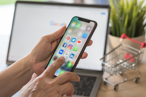 Social Media App Multichannel Icons On Iphone X Touchscreen Mobile Computer Crosschannel Internet Application Technology For Shopping Lifestyle In Digital 40 Age Stock Photo - Download Image Now