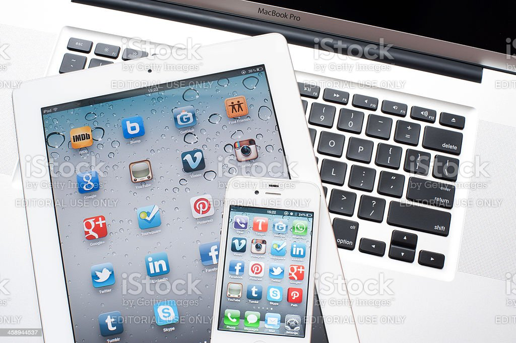 Social Media Applications on iPhone and iPad screen royalty-free stock photo