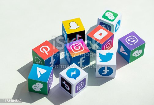 Kyiv, Ukraine - September 5, 2019: A paper cubes collection with printed logos of world-famous social networks and online messengers, such as Facebook, Instagram, YouTube, Telegram and others.