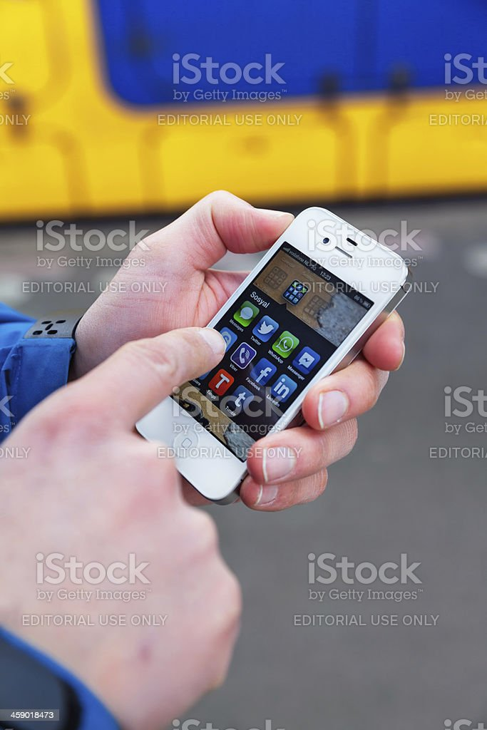 Social media apps on an Apple iPhone 4s white royalty-free stock photo