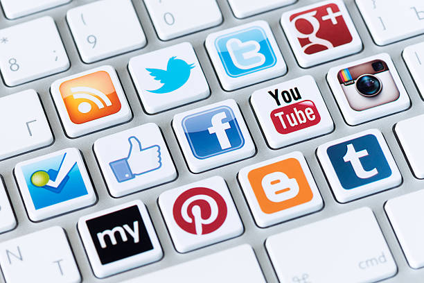 Social media buttons on a computer keyboard stock photo