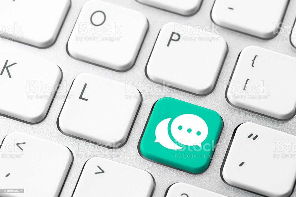 Social media & chat icon on computer keyboard stock photo