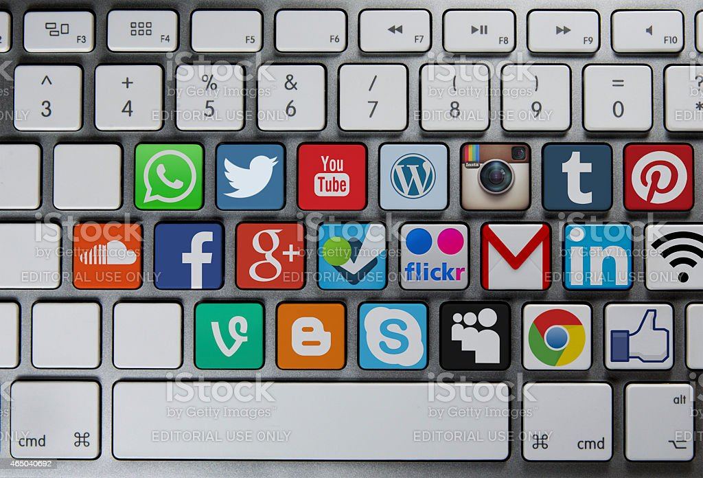 Social media communication icons on keyboard stock photo