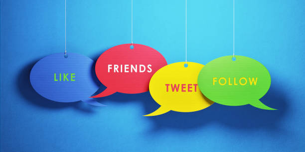 Social Media Concept - Colorful Chat Bubbles Over Blue Background stock photo