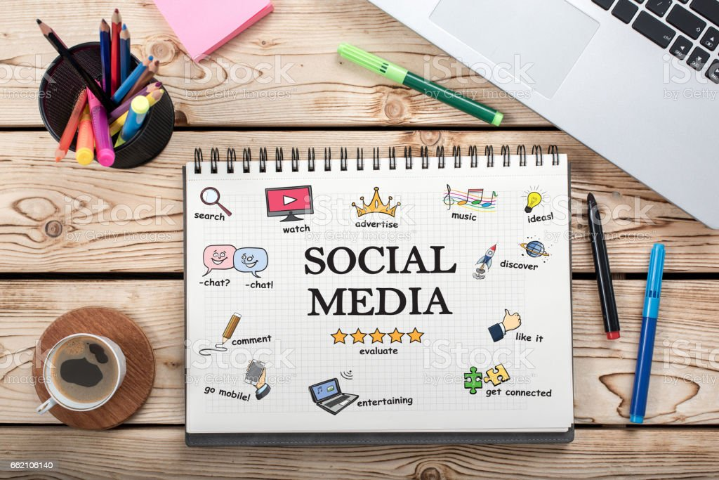 Social Media Concept On Work Desk With Various Doodle Icons stock photo